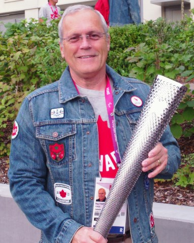 Reg With Olympic Torch