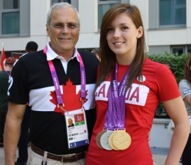 Reg with Summer Mortimer and her medals, at the 2012 Paralympics