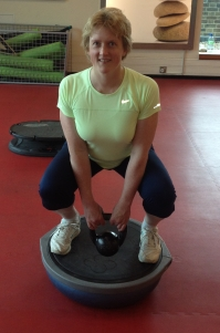 Kettlebell Squat on a Bosu ball